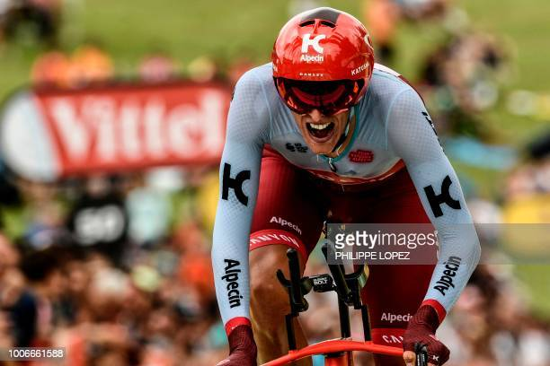 Germany's Nils Politt crosses the finish line of the 20th stage of the 105th edition of the Tour de France cycling race a 31kilometer individual...
