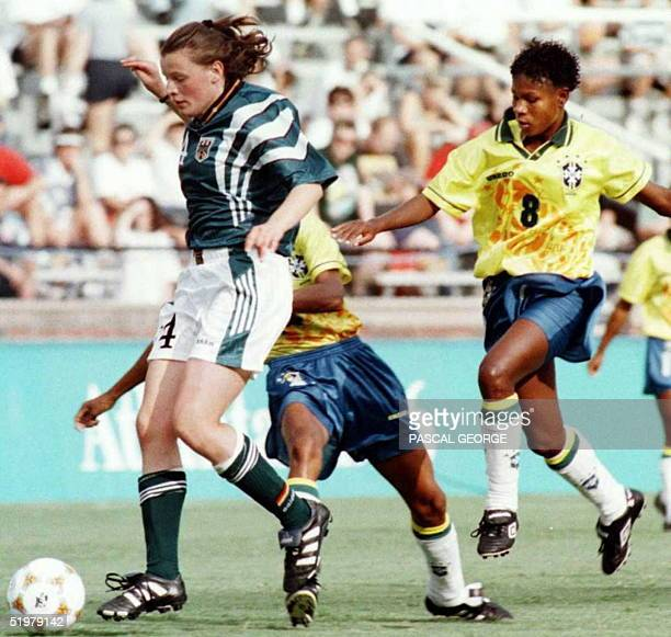 Germany's Olympic soccer team Pia Wunderlich fights for the ball with Brazil's Maciel Miraildes Mota during their women soccer Olympic Group B game...