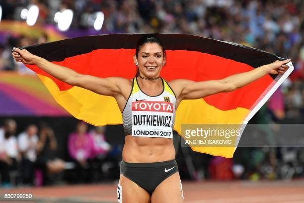 Germany's Pamela Dutkiewicz celebrates coming third and winning bronze in the final of the women's 100m hurdles athletics event at the 2017 IAAF...