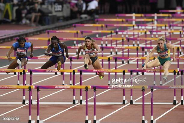 Germany's Pamela Dutkiewicz , United State's Christina Manning and Australia's Dawn Harper Nelson in action during the 100 m Hurdles Final at the...