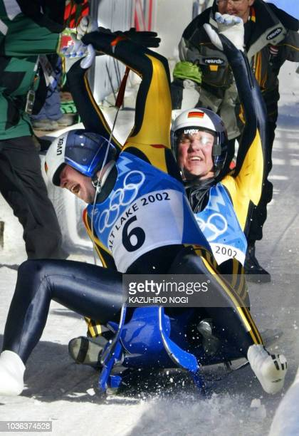 Germany's PatricFritz Leitner and Alexander Resch celebrate after winning the double luge event on the Salt Lake 2002 Olympic Winter Games at the...