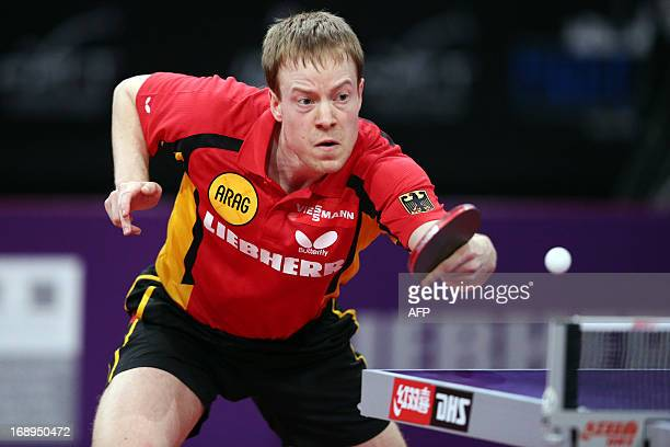 Germany's Patrick Baum competes against France's Emmanuel Lebesson on May 17, 2013 in Paris, during the third round of Men's Singles of the World...