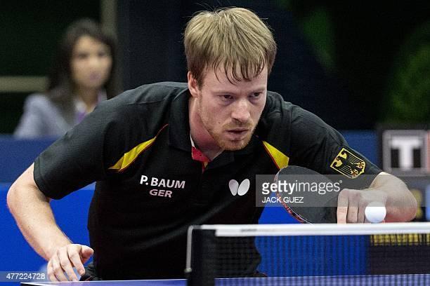 Germany's Patrick Baum returns the ball towards Austria's Daniel Habesohn during the table tennis men's team bronze medal match Germany vs Austria at...