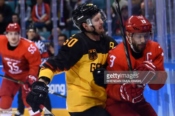 Germany's Patrick Hager collides witnh Russia's Pavel Datsyuk in the men's gold medal ice hockey match between the Olympic Athletes from Russia and...