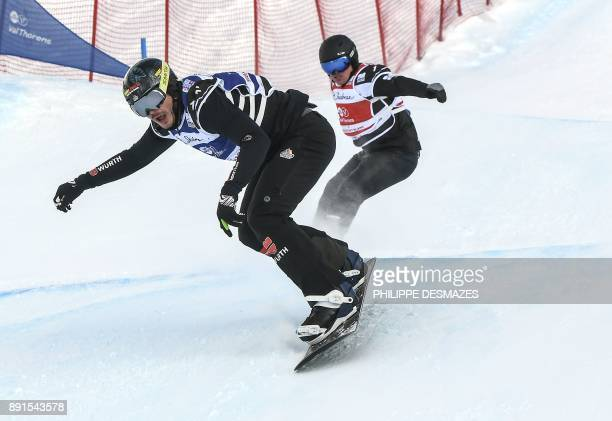 Germany's Paul Berg and Australia's Adam Lambert compete in the final of the FIS Snowboard Cross Men World Cup on December 13 2017 in Val Thorens in...