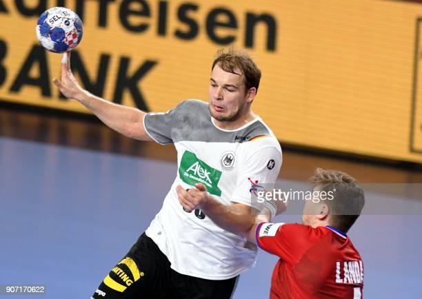 Germany's Paul Drux vies with Czech Republic's Jan Landa during the group II match of the Men's 2018 EHF European Handball Championship between...