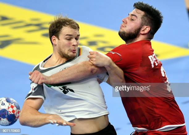 Germany's Paul Drux vies with Czech Republic's Leos Petrovsky during the group II match of the Men's 2018 EHF European Handball Championship between...