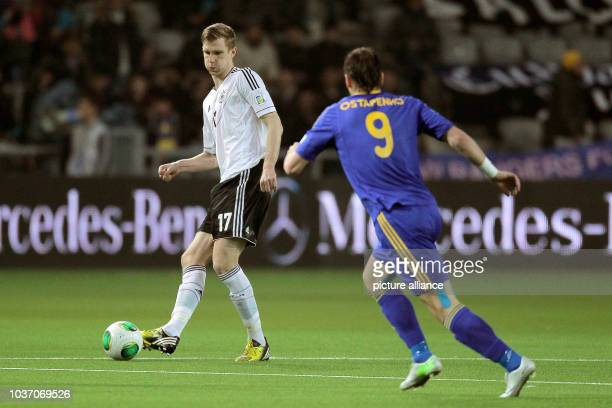 Germany's Per Mertesacker vies for the ball with Kazakhstan's Sergey Ostapenko during the FIFA World Cup 2014 qualification group C soccer match...