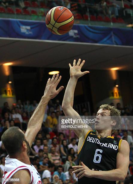 Germany's Per Michael Gunther and Jordan's Idays Ayman during the preliminary round match between Germany and Jordan at the FIBA World Basketball...