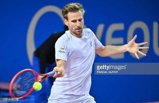 Germany's Peter Gojowczyk returns the ball during his singles semi-final tennis match against Spain's Roberto Bautista Agut during the Open Sud de...
