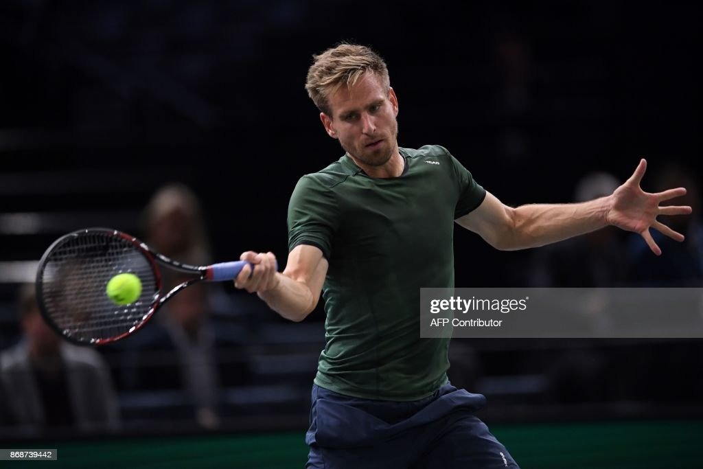 Germany's Peter Gojowczyk returns the ball to Austria's Dominic Thiem during their first round match at the ATP World Tour Masters 1000 indoor tennis tournament on October 31, 2017 in Paris. /