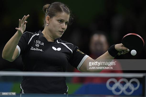 Germany's Petrissa Solja hits a shot in the women's team semi-final table tennis match against Japan at the Riocentro venue during the Rio 2016...