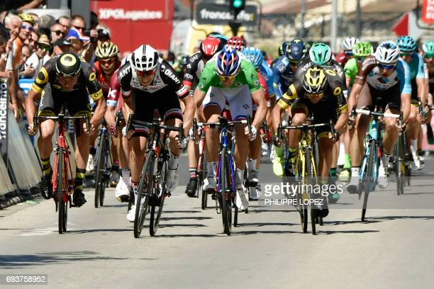 TOPSHOT Germany's Phil Bauhaus sprints to win ahead of France's Arnaud Demare wearing the best sprinter's green jersey at the end of the 1755 km...