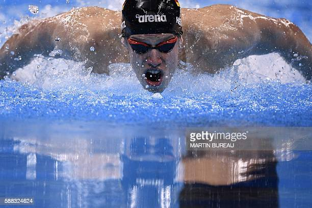 Germany's Philip Heintz competes in the Men's 200m Individual Medley Semifinal during the swimming event at the Rio 2016 Olympic Games at the Olympic...