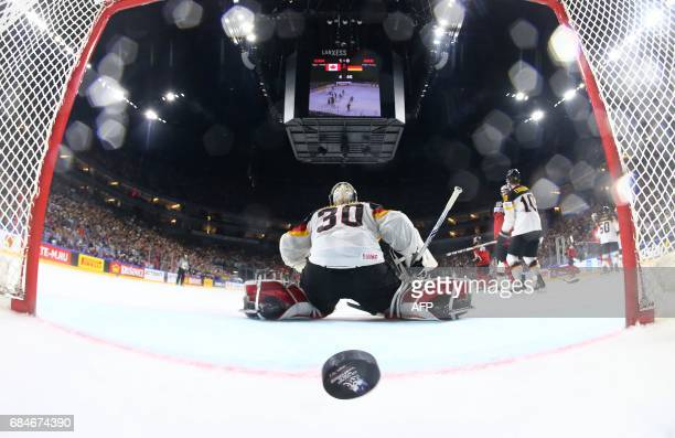 TOPSHOT Germany's Philipp Grubauer fails to make a save during the IIHF Men's World Championship Ice Hockey quarterfinal match between Canada and...