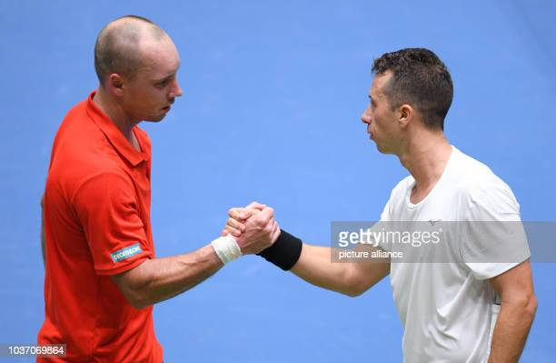 Germany's Philipp Kohlschreiber and Belgium's Steve Darcis shake hands after the Davis Cup World Group match between Germany and Belgium at the...