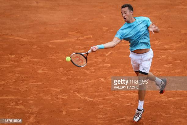 Germany's Philipp Kohlschreiber plays a forehand return to Serbia's Novak Djokovic during their tennis match on the day 4 of the MonteCarlo ATP...