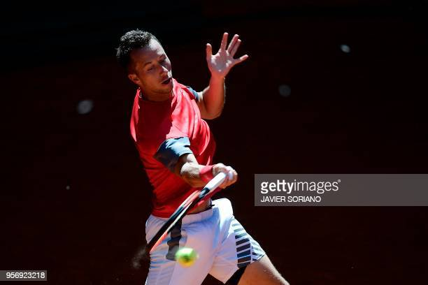 Germany's Philipp Kohlschreiber returns the ball to South Africa's Kevin Anderson during their ATP Madrid Open round of 16 tennis match at the Caja...
