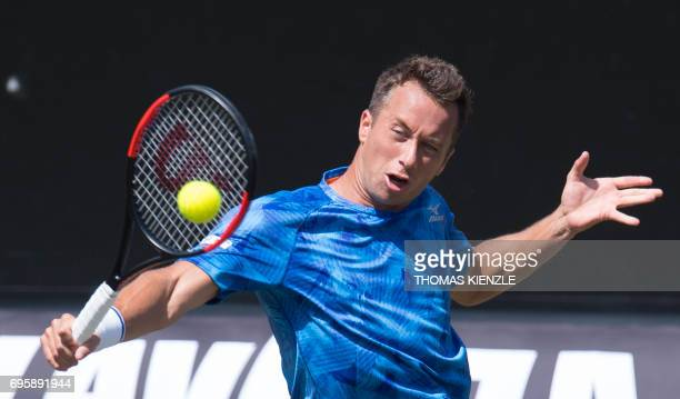 Germany's Philipp Kohlschreiber returns the ball to Steve Johnson of the US in their round of sixteen match at the ATP Mercedes Cup tennis tournament...