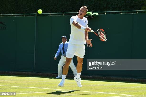Germany's Philipp Kohlschreiber returns to Russia's Evgeny Donskoy during their men's singles first round match on the first day of the 2018...