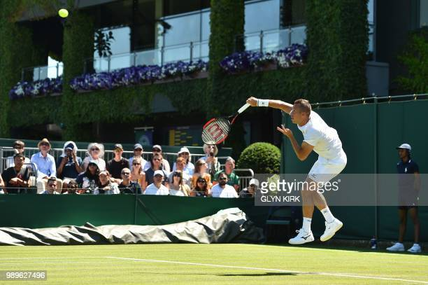 Germany's Philipp Kohlschreiber serves to Russia's Evgeny Donskoy during their men's singles first round match on the first day of the 2018 Wimbledon...
