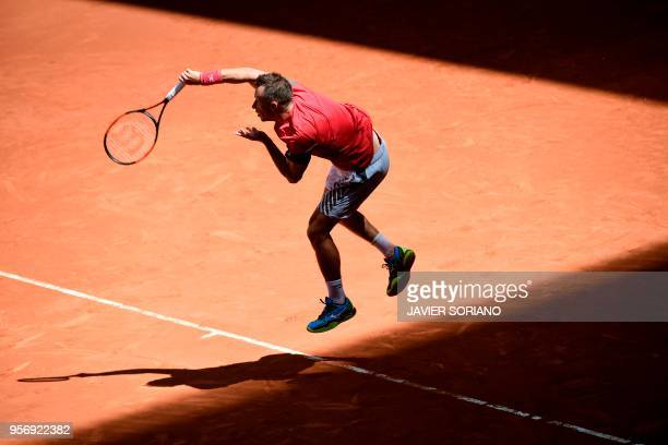 Germany's Philipp Kohlschreiber serves to South Africa's Kevin Anderson during their ATP Madrid Open round of 16 tennis match at the Caja Magica in...