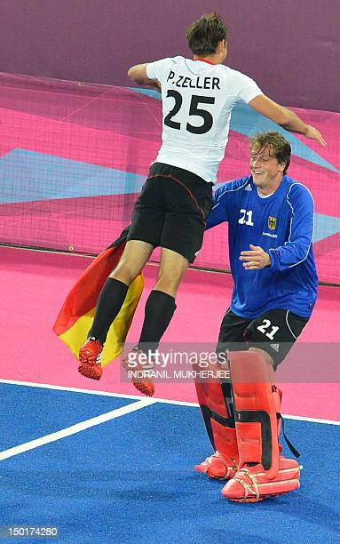 Germany's Philipp Zeller and Max Weinhold react after the men's field hockey gold medal match Germany vs the Netherlands at the London 2012 Olympic...