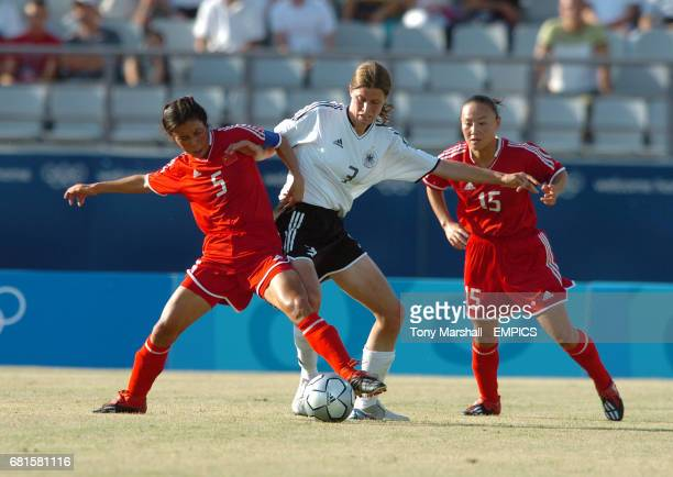 Germany's Pia Wunderlich tackle China's Yunjie Fan