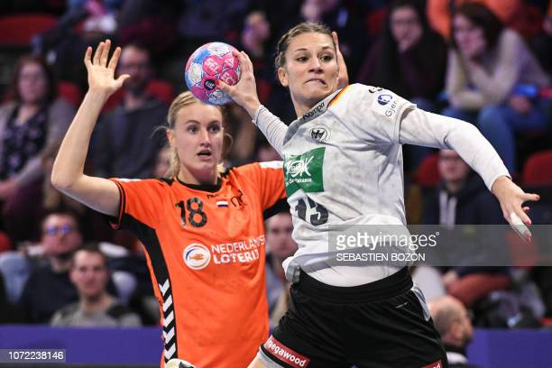 Germany's pivot Julia Behnke shoots during the 2018 European Women's handball Championships Group 2 main round match between Netherlands and Germany...