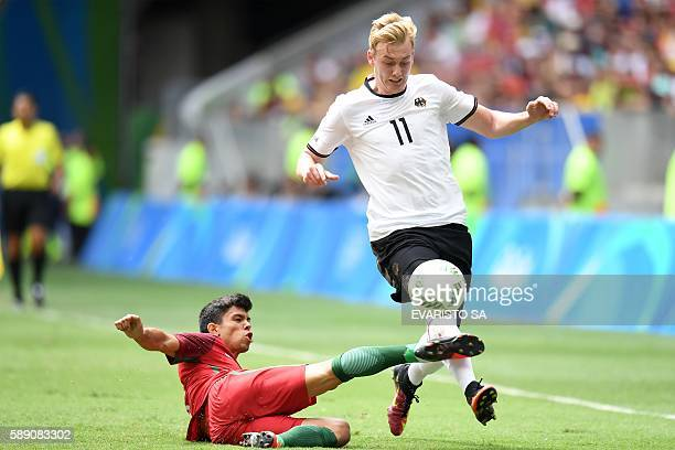 Germany's player Julian Brandt vies for the ball with Portugal's player Andre during the Rio 2016 Olympic Games Quarterfinals men's football match...