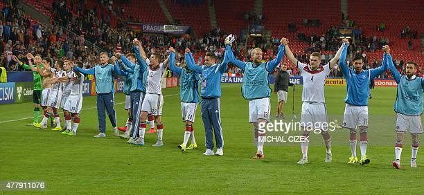 Germany's players acknowledge their supporters after the Euro 2015 U21 group A match between Germany and Denmark on June 20 at the Eden stadium in...
