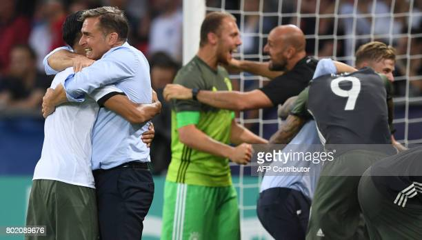 Germany's players and head coach Stefan Kuntz celabrating after the 32 victory on penalties during the UEFA U21 European Championship football semi...