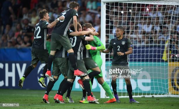 Germany's players celabrating after the 32 victory on penalties during the UEFA U21 European Championship football semi final match England v Germany...