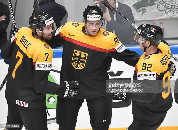 Germany's players celebrate a goal during the group B preliminary round game Germany vs Belarus at the 2016 IIHF Ice Hockey World Championship in...