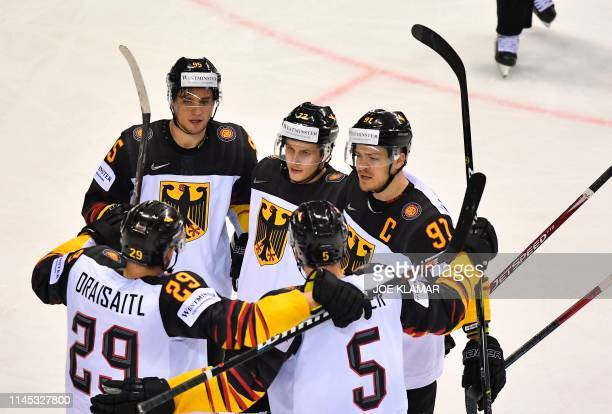 Germany's players celebrate after Germany's forward Dominik Kahun scored the 22 during the IIHF Men's Ice Hockey World Championships Group A match...