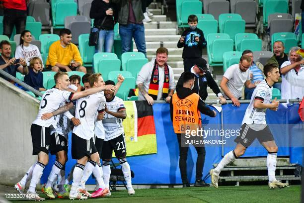 Germanys players celebrate after scoring during the 2021 UEFA European Under-21 Championship final football mat thech between Germany and Portugal at...