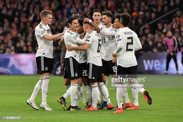 Germany's players celebrate after scoring during the UEFA Euro 2020 Group C qualification football match between The Netherlands and Germany at the...