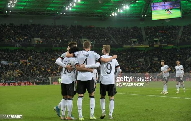 Germany's players celebrate after scoring during the UEFA Euro 2020 Group C qualification football match between Germany and Belarus on November 16...