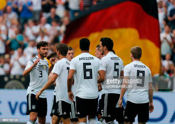 Germany's players celebrate after scoring the 10 during the international friendly football match between Germany and Saudi Arabia at the BayArena...