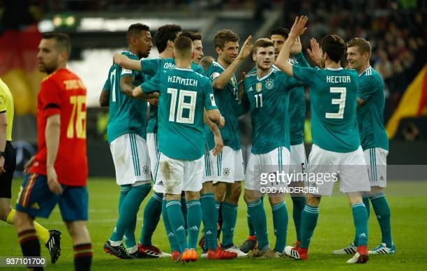 Germany's players celebrate after scoring the 11 during the international friendly football match of Germany vs Spain in Duesseldorf western Germany...