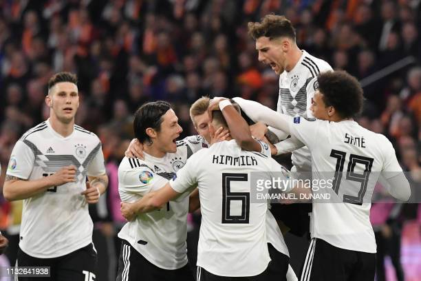 Germany's players celebrate after scoring their second goal during the UEFA Euro 2020 Group C qualification football match between The Netherlands...