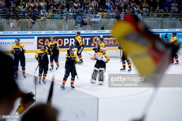 Germany's players celebrate after the international ice hockey friendly match between Germany and Slovakia at Energieverbund Arena on April 15 2018...
