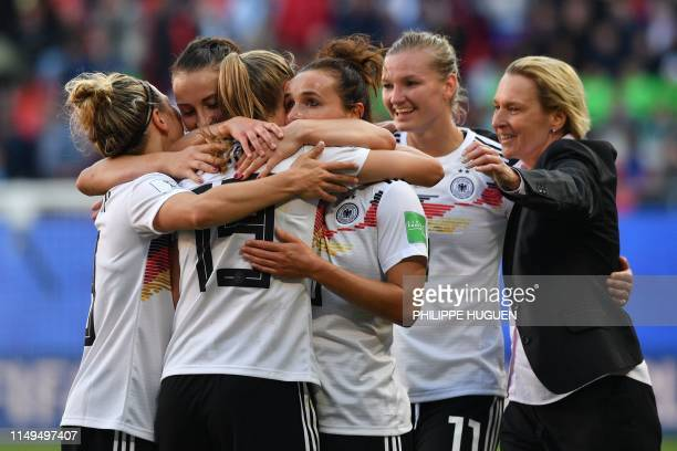 Germany's players celebrate after winning during the France 2019 Women's World Cup Group B football match between Germany and Spain, on June 12 at...