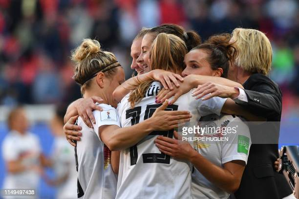 Germany's players celebrate after winning during the France 2019 Women's World Cup Group B football match between Germany and Spain on June 12 at the...