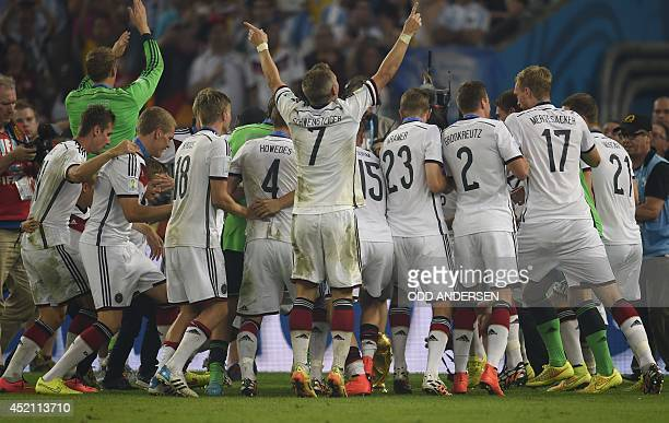 Germany's players celebrate after winning the 2014 FIFA World Cup final football match between Germany and Argentina 10 following extratime at the...