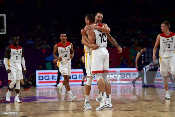 Germany's players celebrate after winning the FIBA Eurobasket 2017 men's round 16 basketball match between Germany and France at Sinan Erdem Sport...