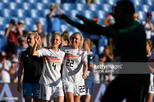 Germany's players celebrate after winning the France 2019 Women's World Cup Group B football match between South Africa and Germany, on June 17 at...