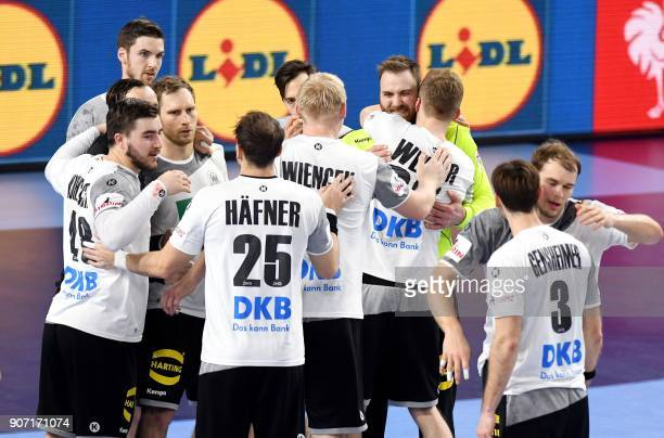 Germany's players celebrate after winning the group II match of the Men's 2018 EHF European Handball Championship between Germany and Czech Republic...