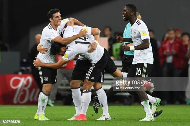 Germany's players celebrate at the end of the 2017 Confederations Cup final football match between Chile and Germany at the Saint Petersburg Stadium...