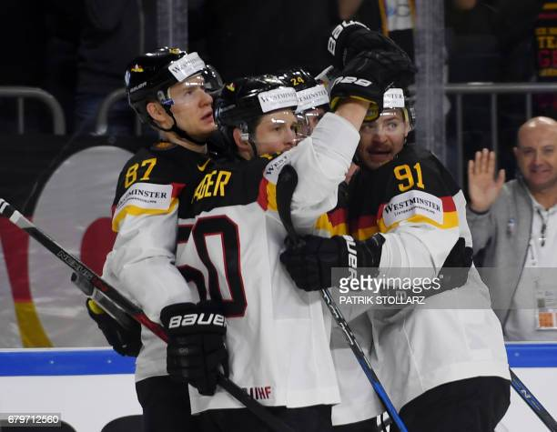 Germany´s players celebrate during IIHF Icehockey world championship first round match between Sweden and Germany in the LANXESS arena in Cologne...